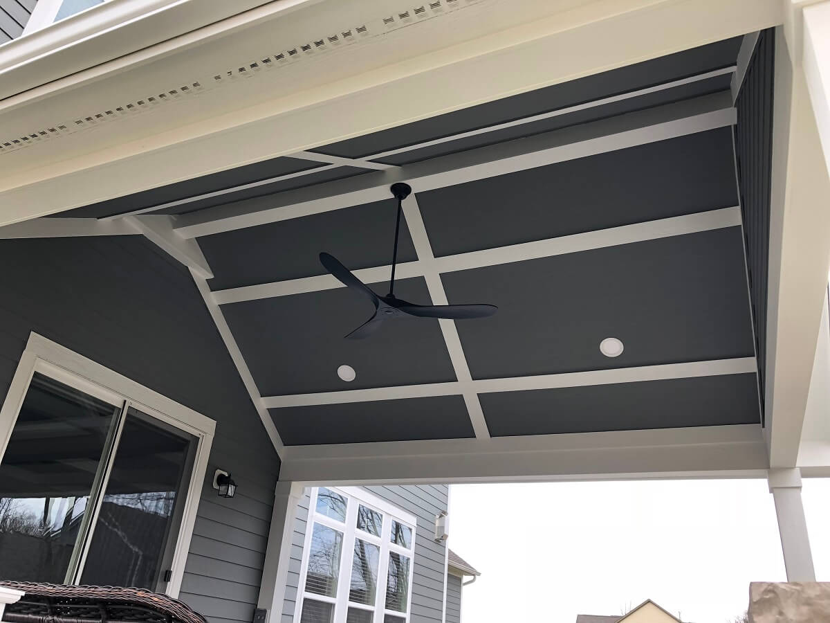 Covered porch ceiling detail with fan and lighting