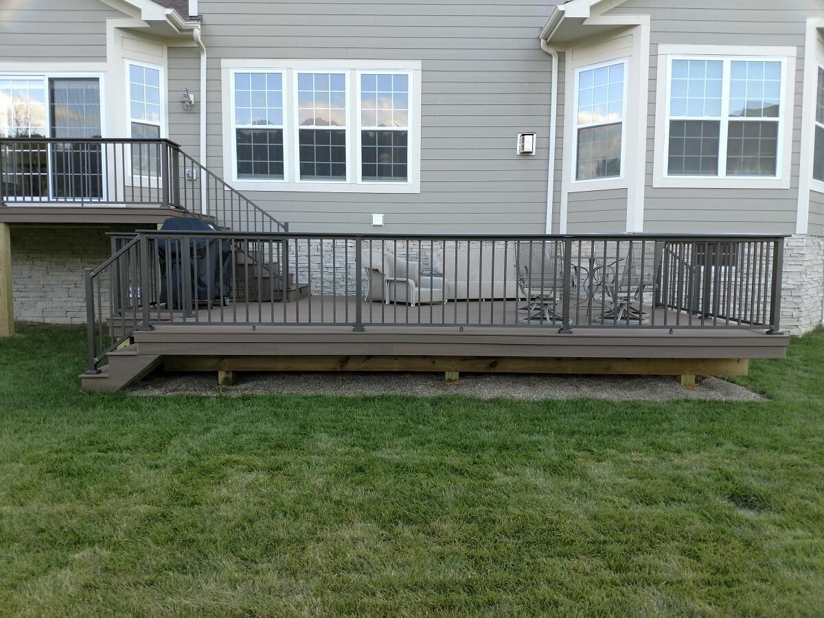 Custom backyard multi-level deck with seating area