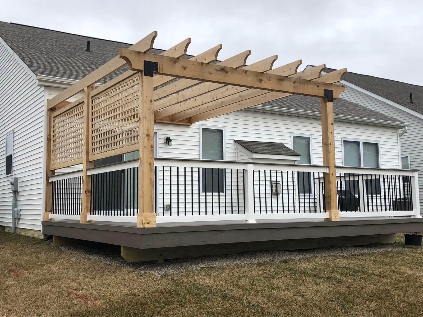 Custom backyard deck with wood pergola