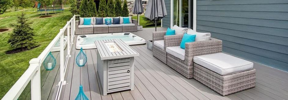Cozy custom backyard deck with hot tub