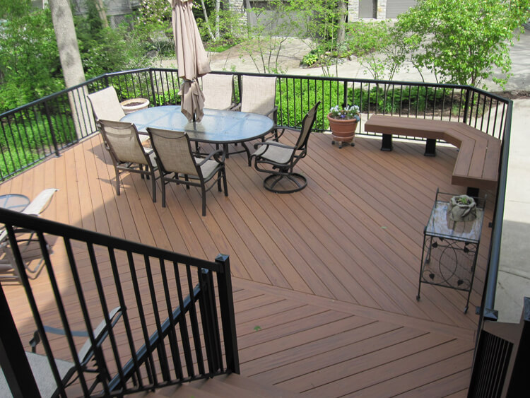 Custom deck with dining area and floating bench