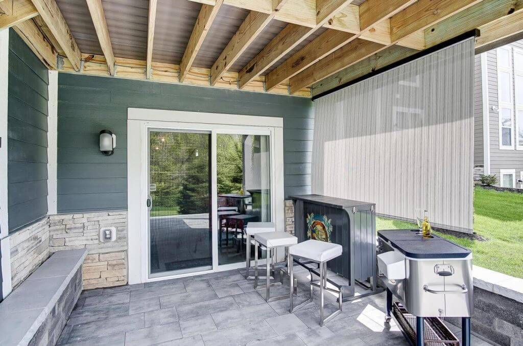 Under deck space with outdoor kitchen and bar counter