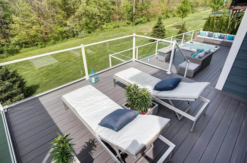 Cozy multi-level deck with lounge area and hot tub