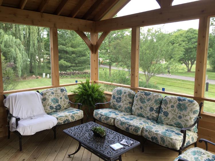 Cedar screened porch with drink rail.