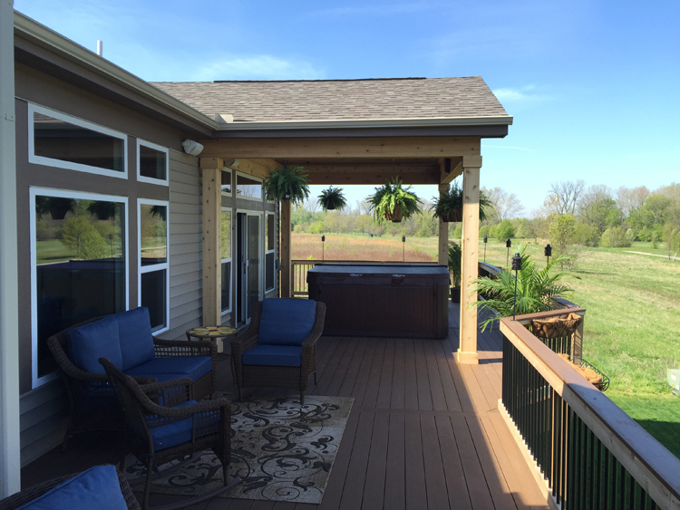 Deck and open porch with hot tub in Columbus.