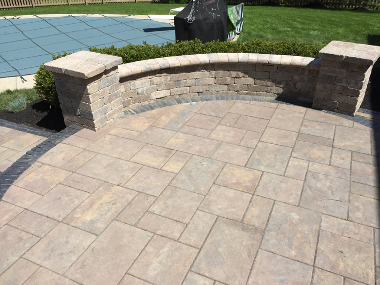 Paver patio with seating wall.