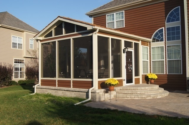 Screened porch with patio features within porch.