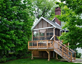 screened porch with deck and staircase