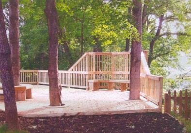 wood deck built around natural trees