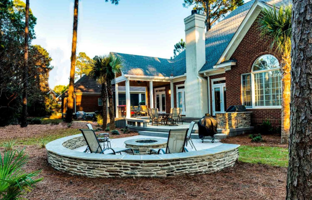 Custom backyard patio with fire pit