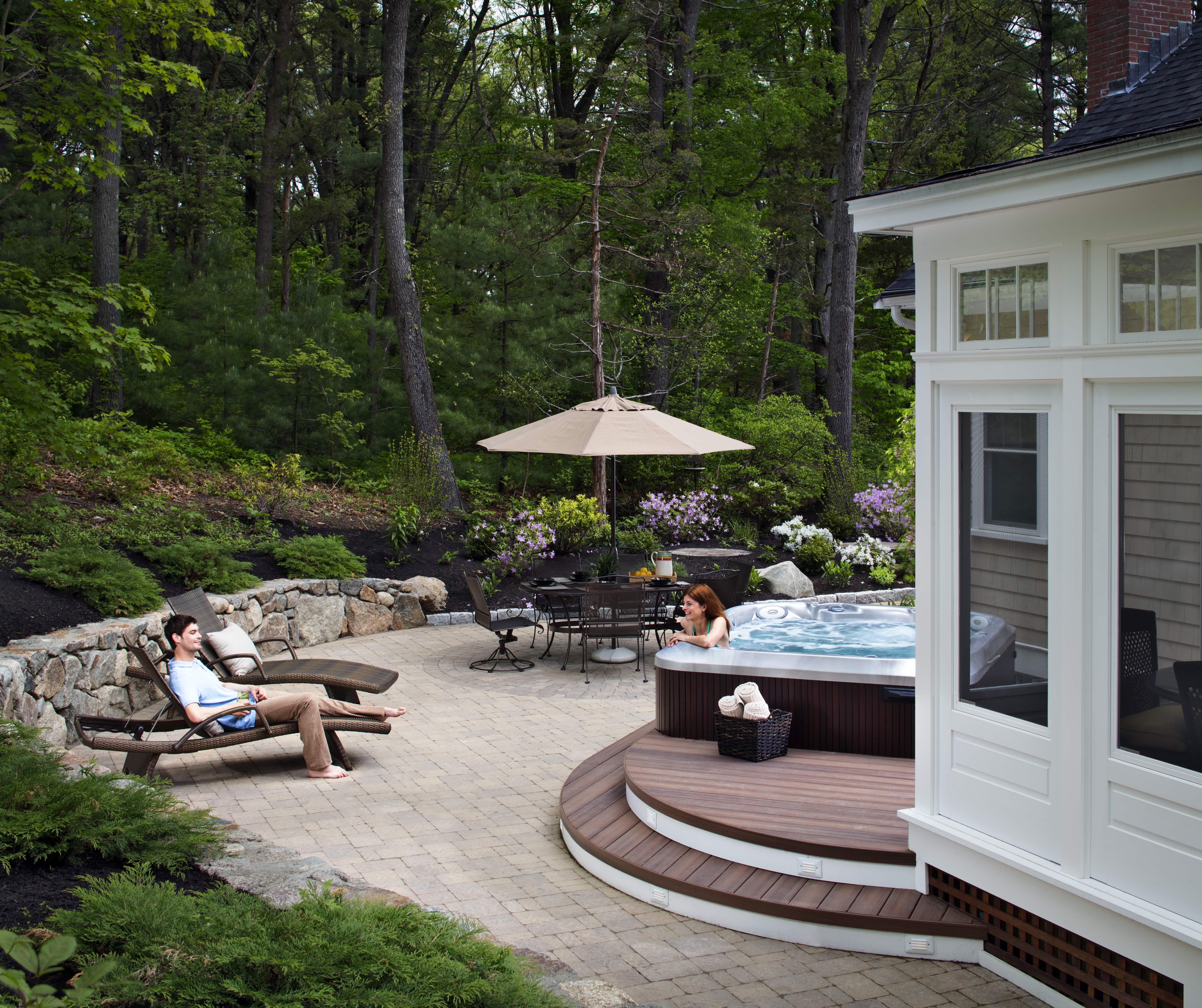 Couple enjoying lounging on patio and hot tub