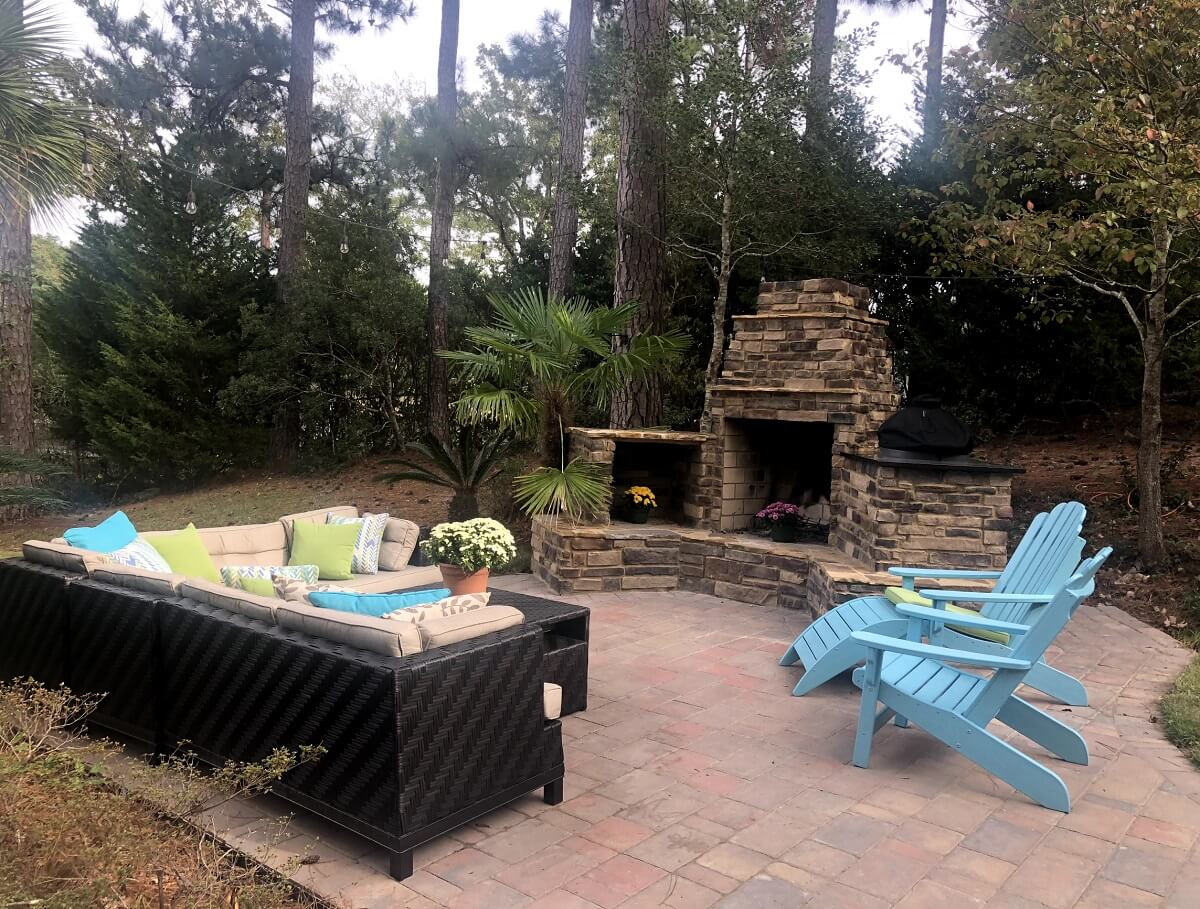 Custom patio with seating area and stone outdoor fireplace
