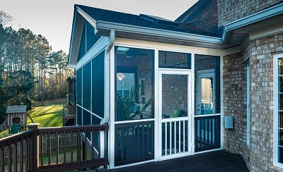 Side view of custom backyard screened porch
