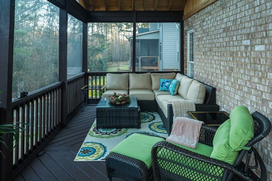 Interior view of screened porch seating area
