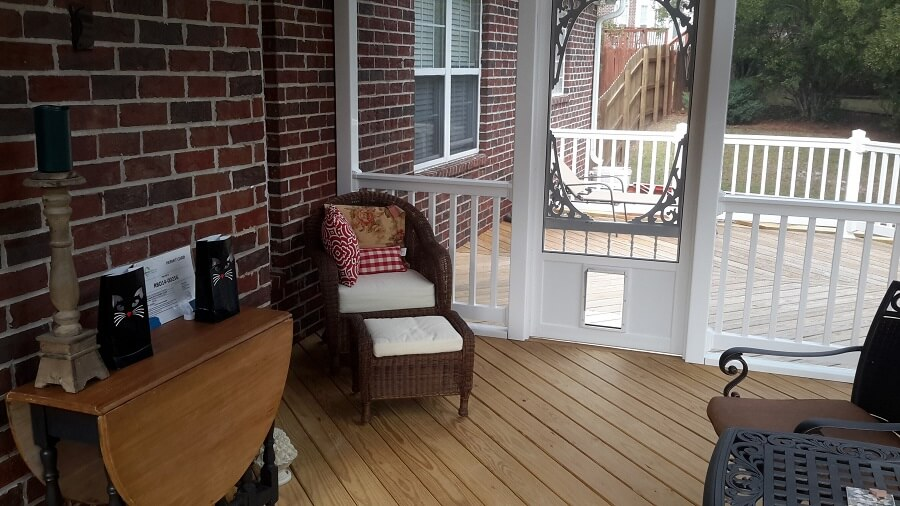 Interior view of custom sunroom with seating area