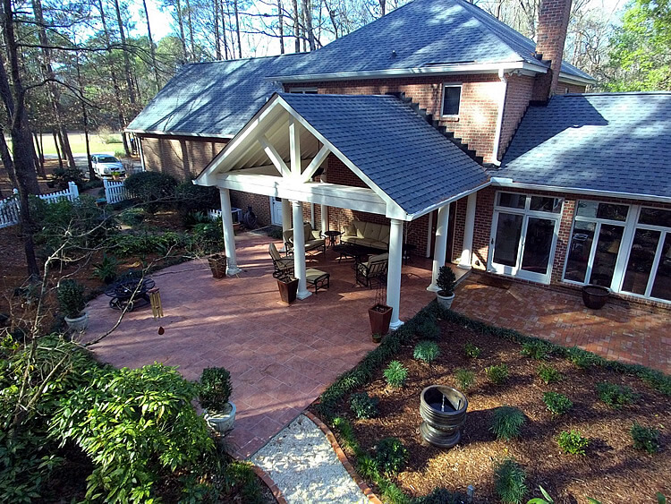 Custom backyard covered porch and open patio