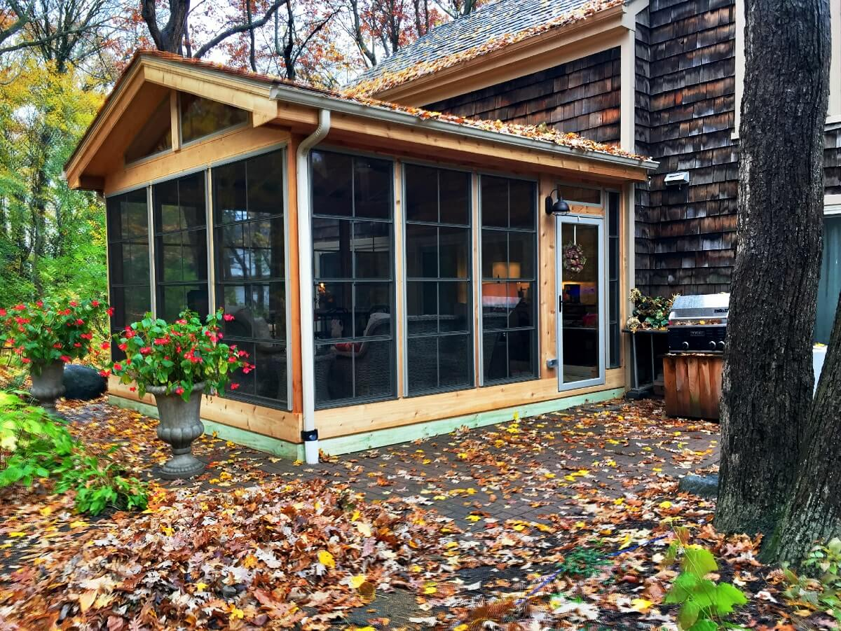 Custom screened porch surrounded with fallen leaves