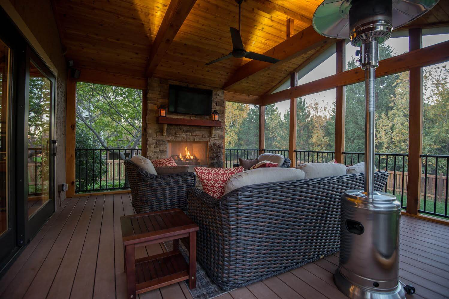Cozy screened room with outdoor fireplace