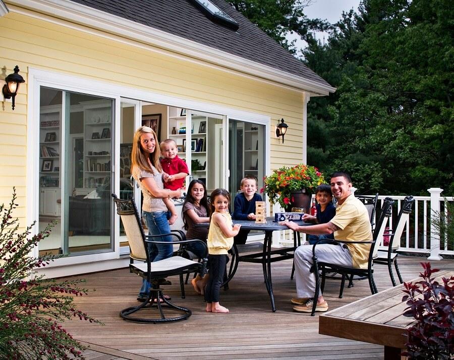 Family enjoying family time on house deck
