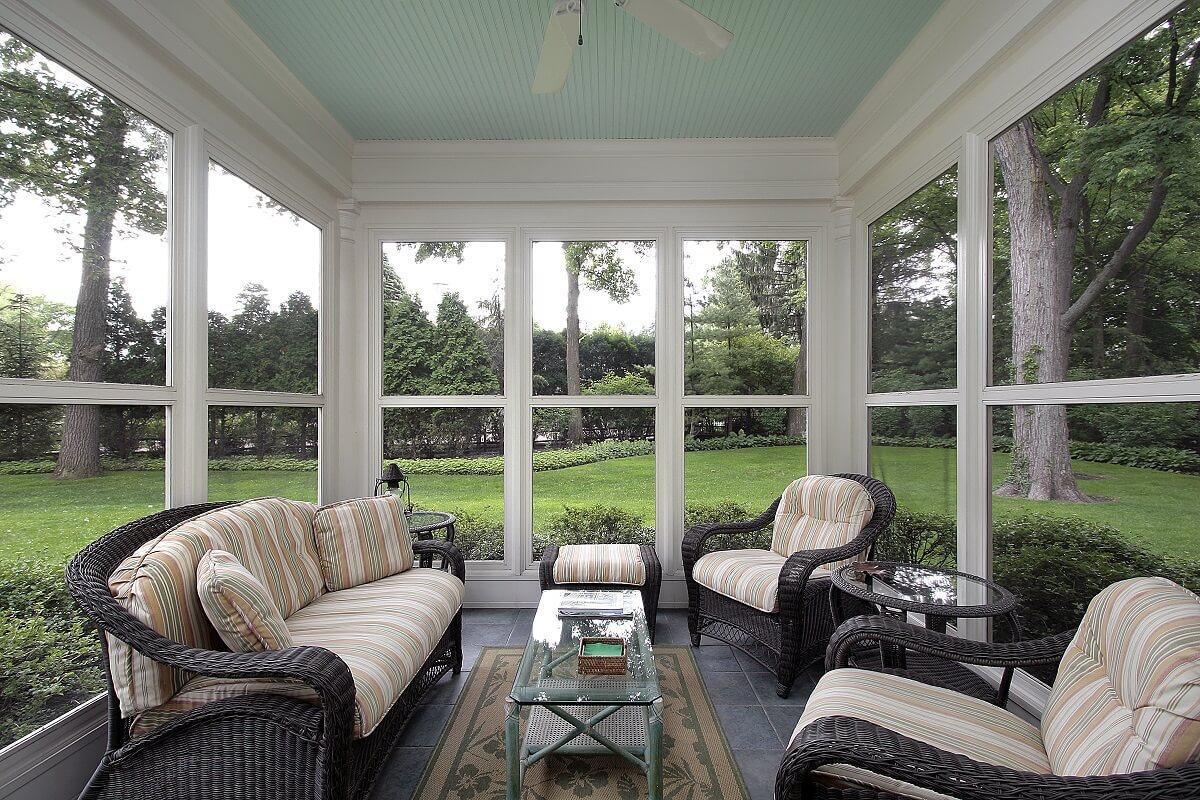 Custom three season room with backyard view