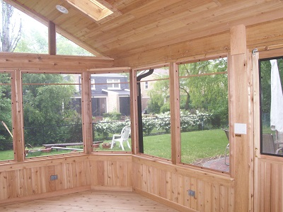 Interior view of cedar screened porch with backyard view