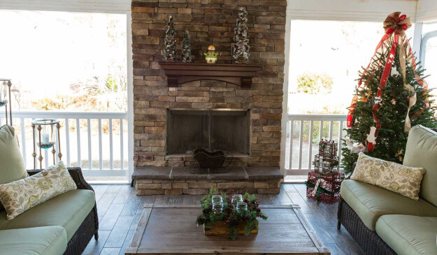 Screened porch with fireplace and Christmas decors
