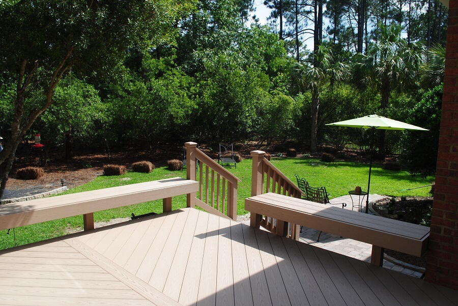 Backyard wood deck with floating benches