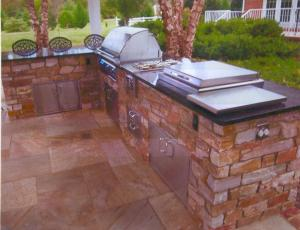 """This multi-functional outdoor kitchen features """"eat in"""" style bar seating"""