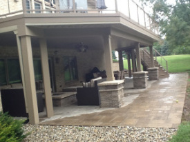 Notice how the area underneath the deck is dry while the rest is wet?