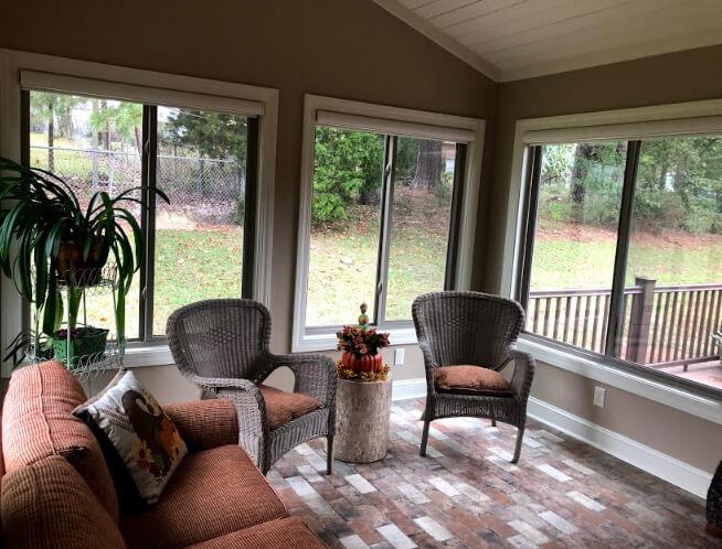 Cozy interior of sunroom with backyard view