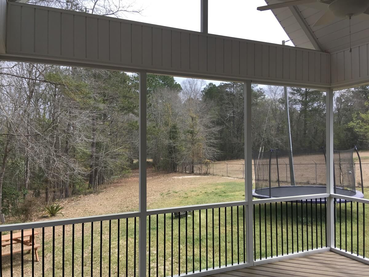 Backyard view from inside screened porch