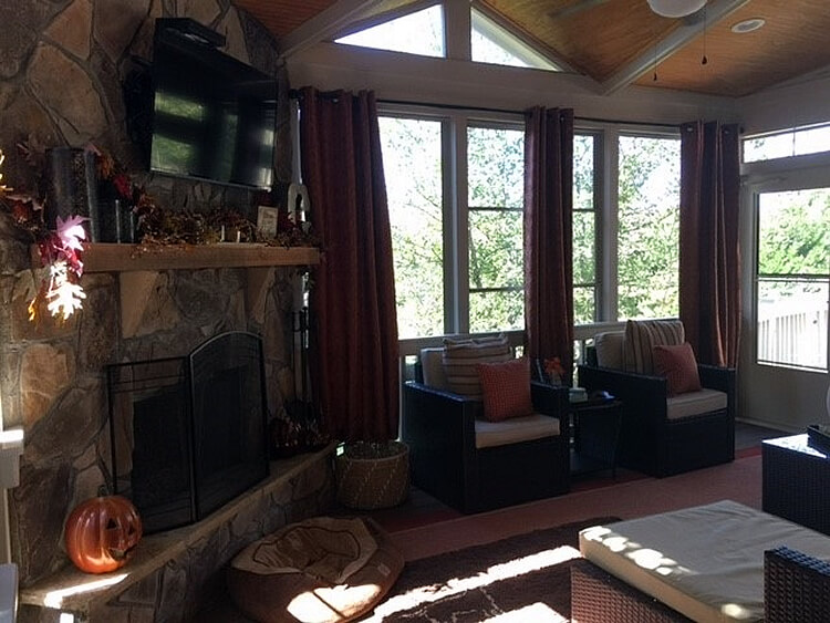 3-season room with TV and fireplace