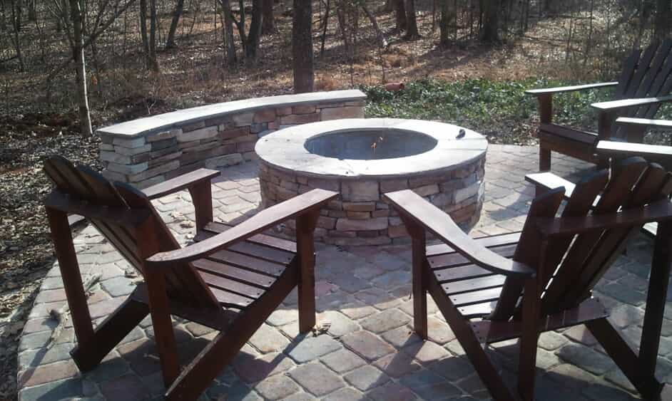 built in firepit with seating wall patio and chairs