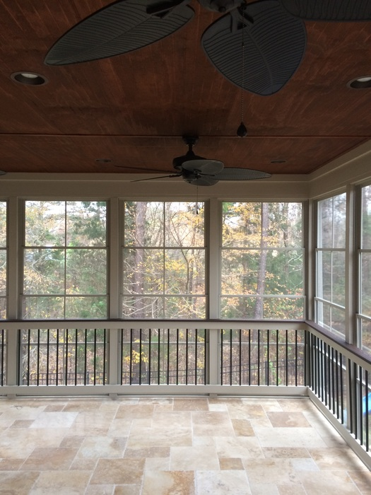 Enclosed porch with ceiling fans and floor to ceiling windows
