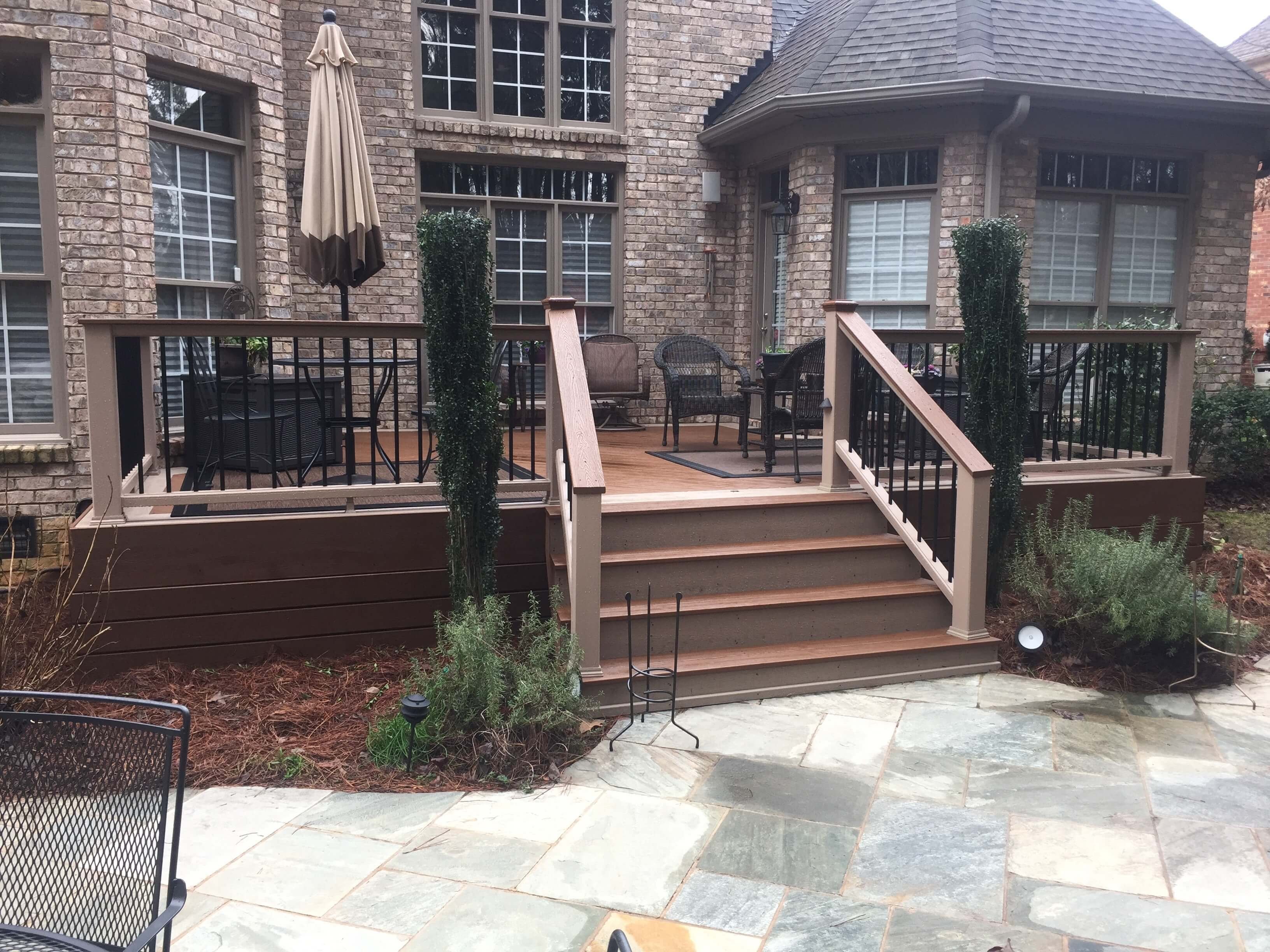 wood deck with chairs and plants