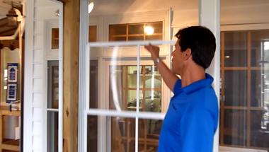 man opening a window