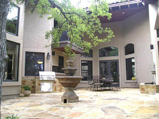 patio with fountain and outdoor kitchen