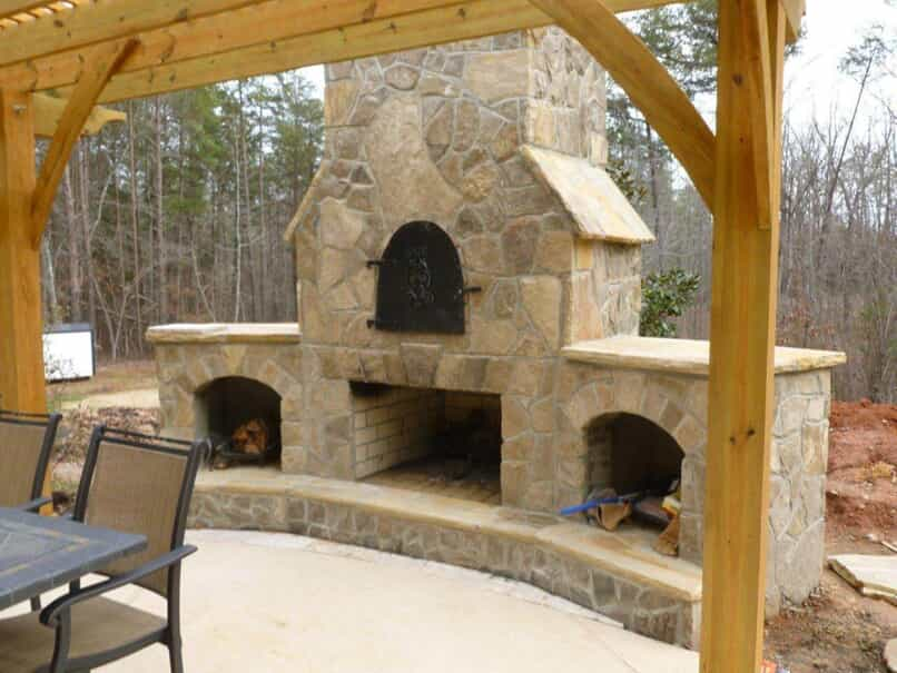 outdoor stone fireplace with built in storage