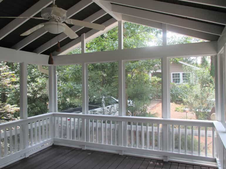 3 season room with floor to ceiling windows and vaulted ceiling