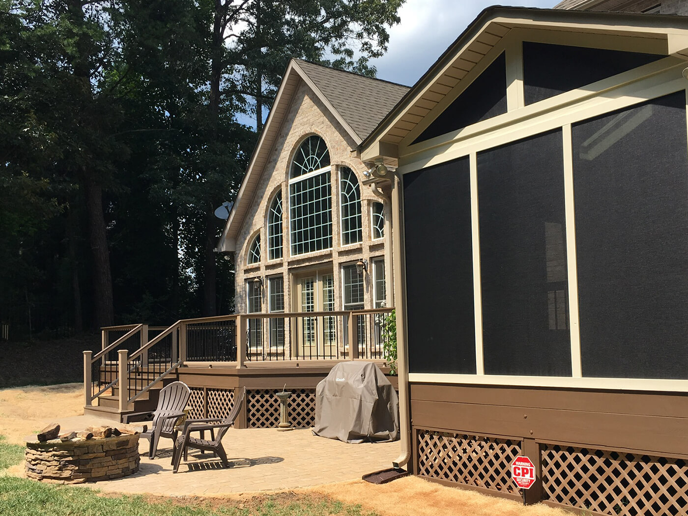 screened porch and deck with fire pit