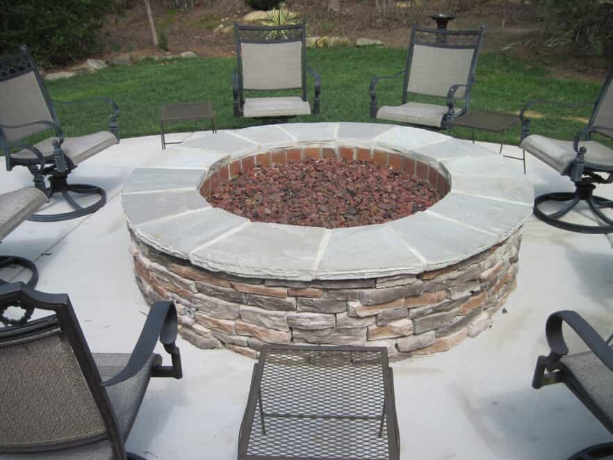 circular, gas, built in, outdoor firepit with chairs all around it
