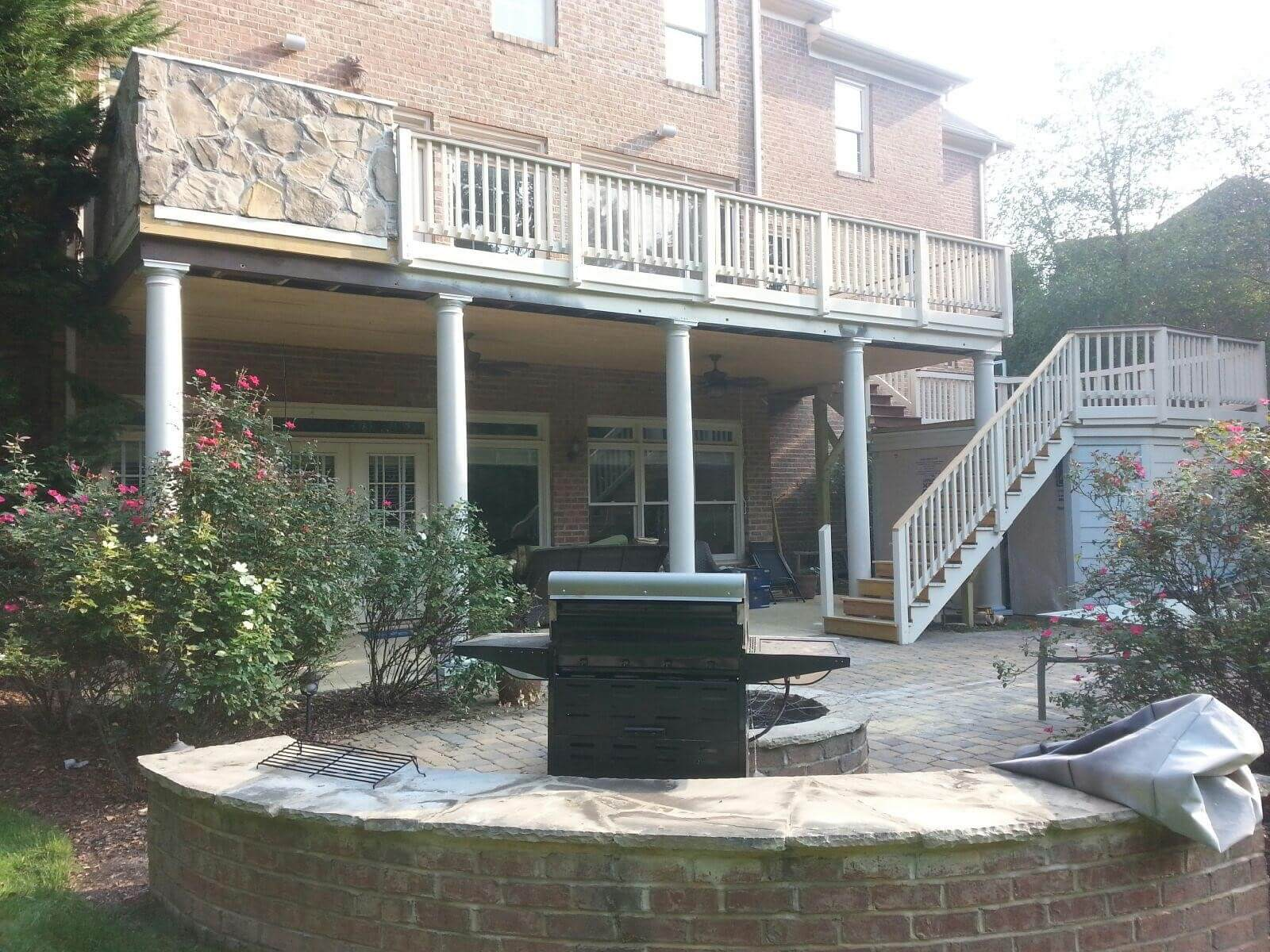 Custom deck and patio with outdoor kitchen and fire pit