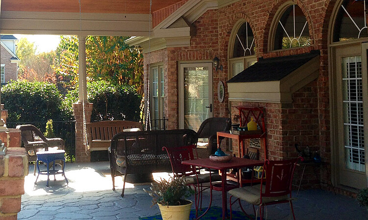 Custom covered porch patio with porch swing and seats