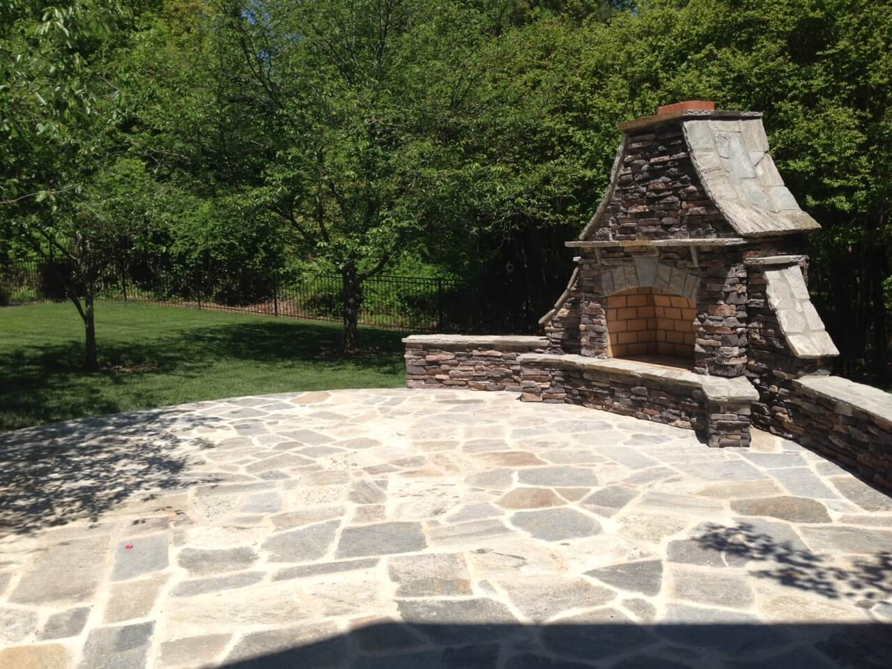 Custom flagstone patio with outdoor fireplace