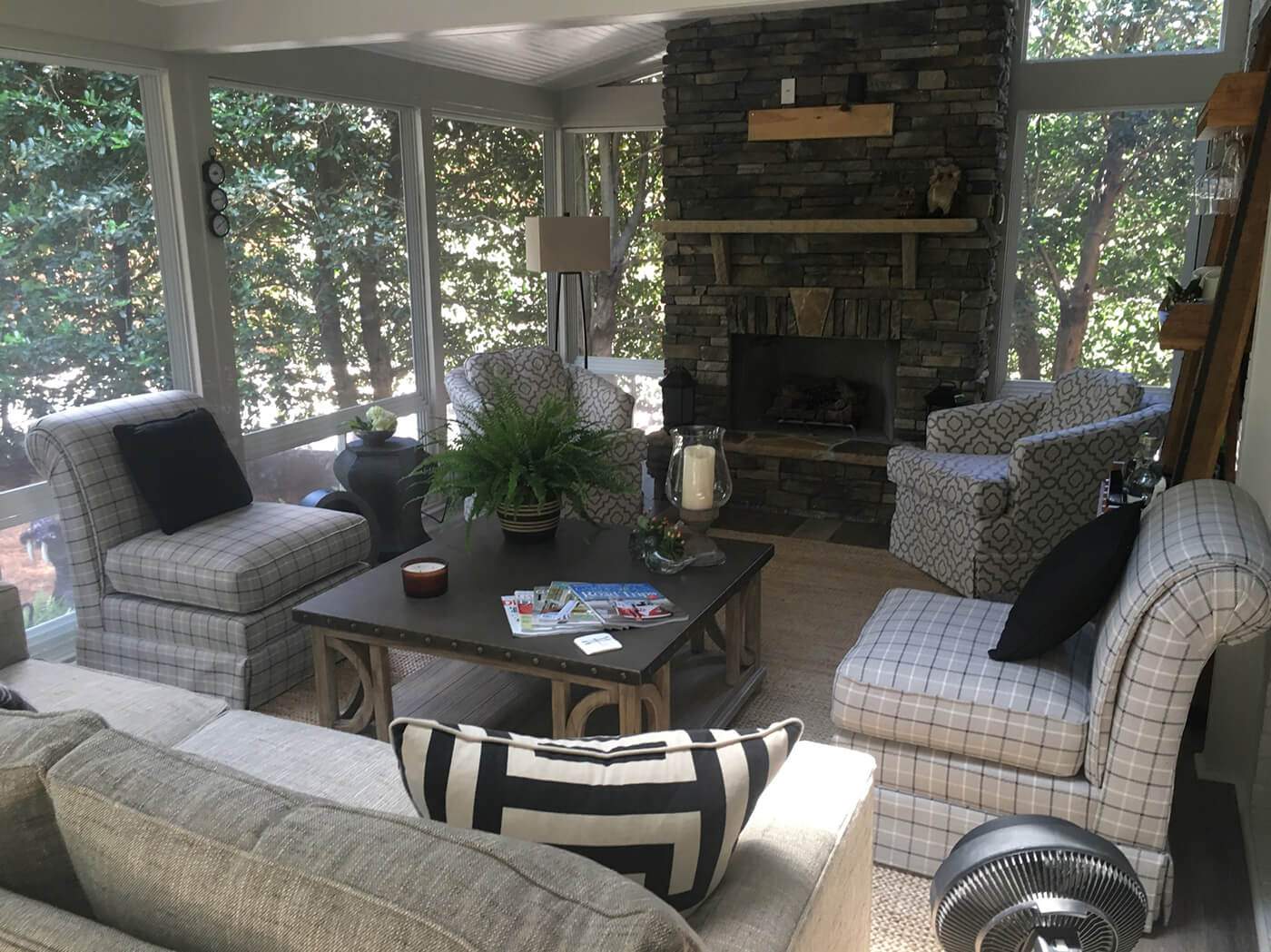 Cozy custom screened porch with outdoor fireplace