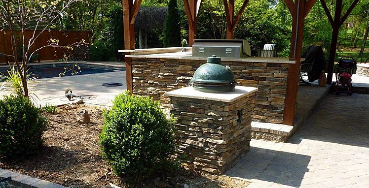 Custom stone facade outdoor kitchen