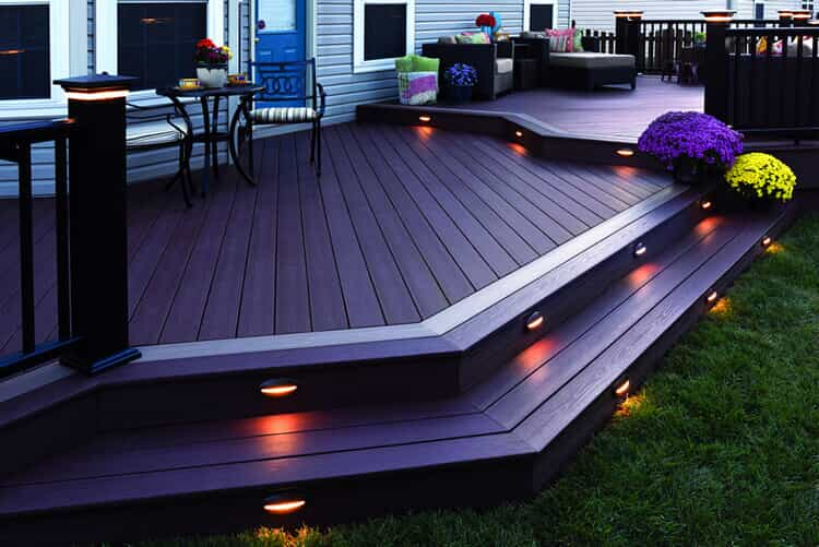 deck with lighting on the railing and the stairs