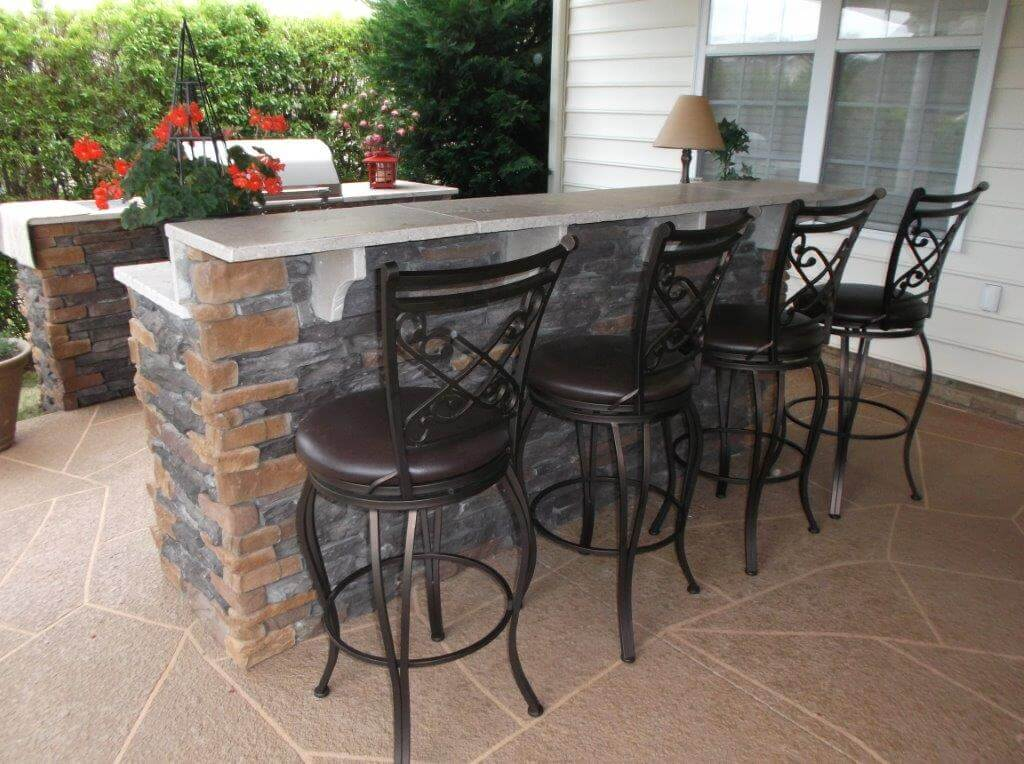 patio with bar and outdoor kitchen