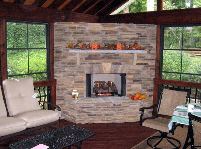 outdoor fireplace with fall decorations