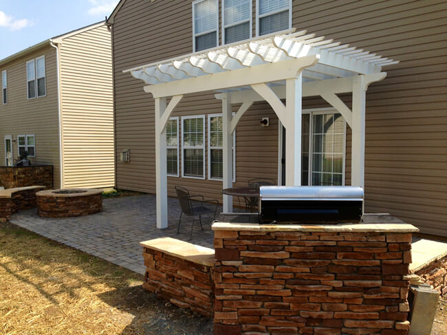 paver patio with covering and barbecue